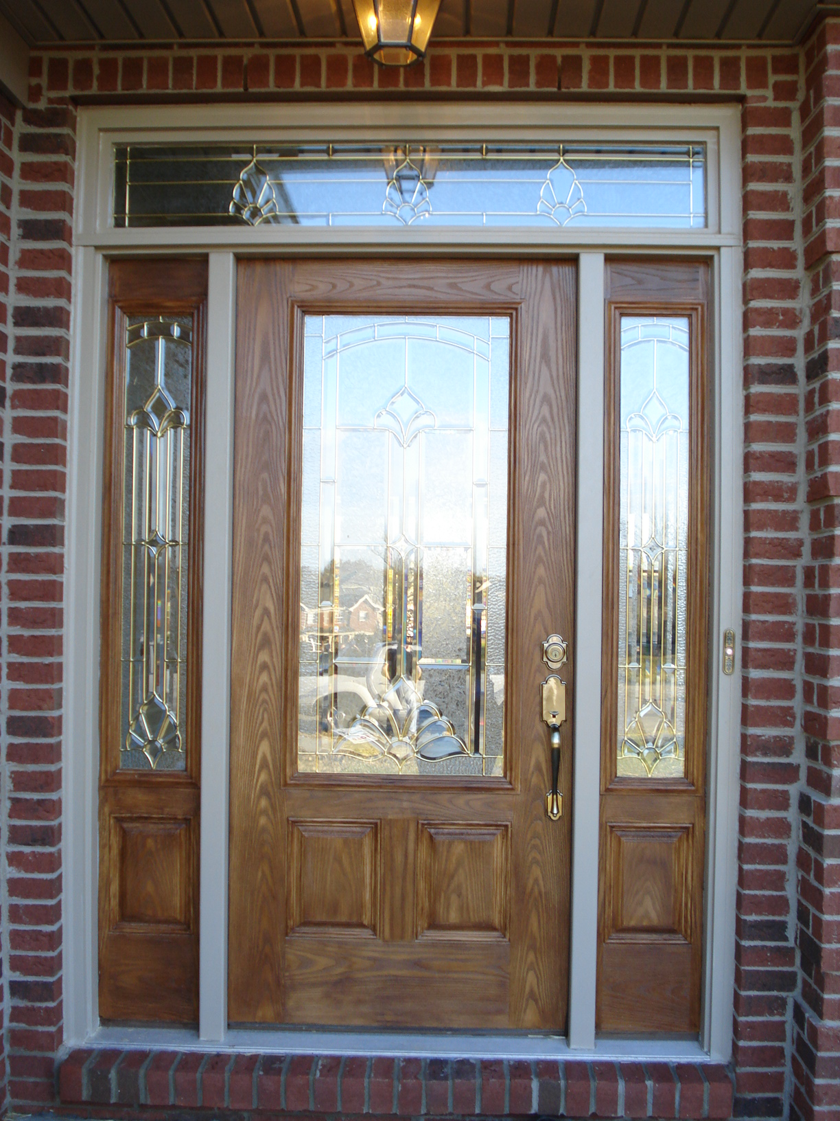 peru therma tru entry doors with golden handle matched with brick wall ideas