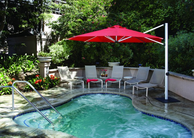 Red Cantilever Umbrella Plus Chairs Near The Swimming Pool For Patio Decor Ideas