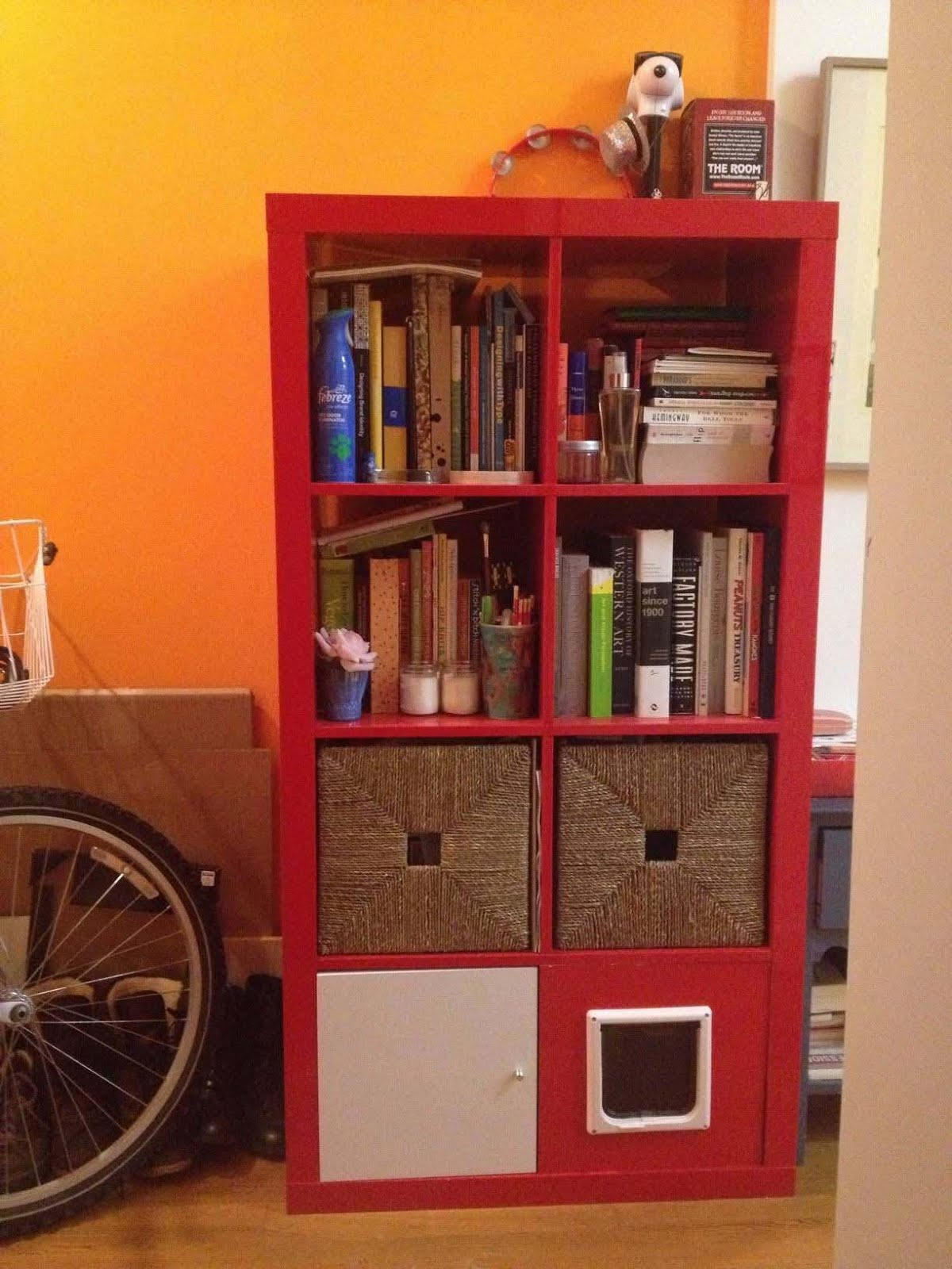 red ikea expedit bookcase with drawer and books ideas before yellow wall