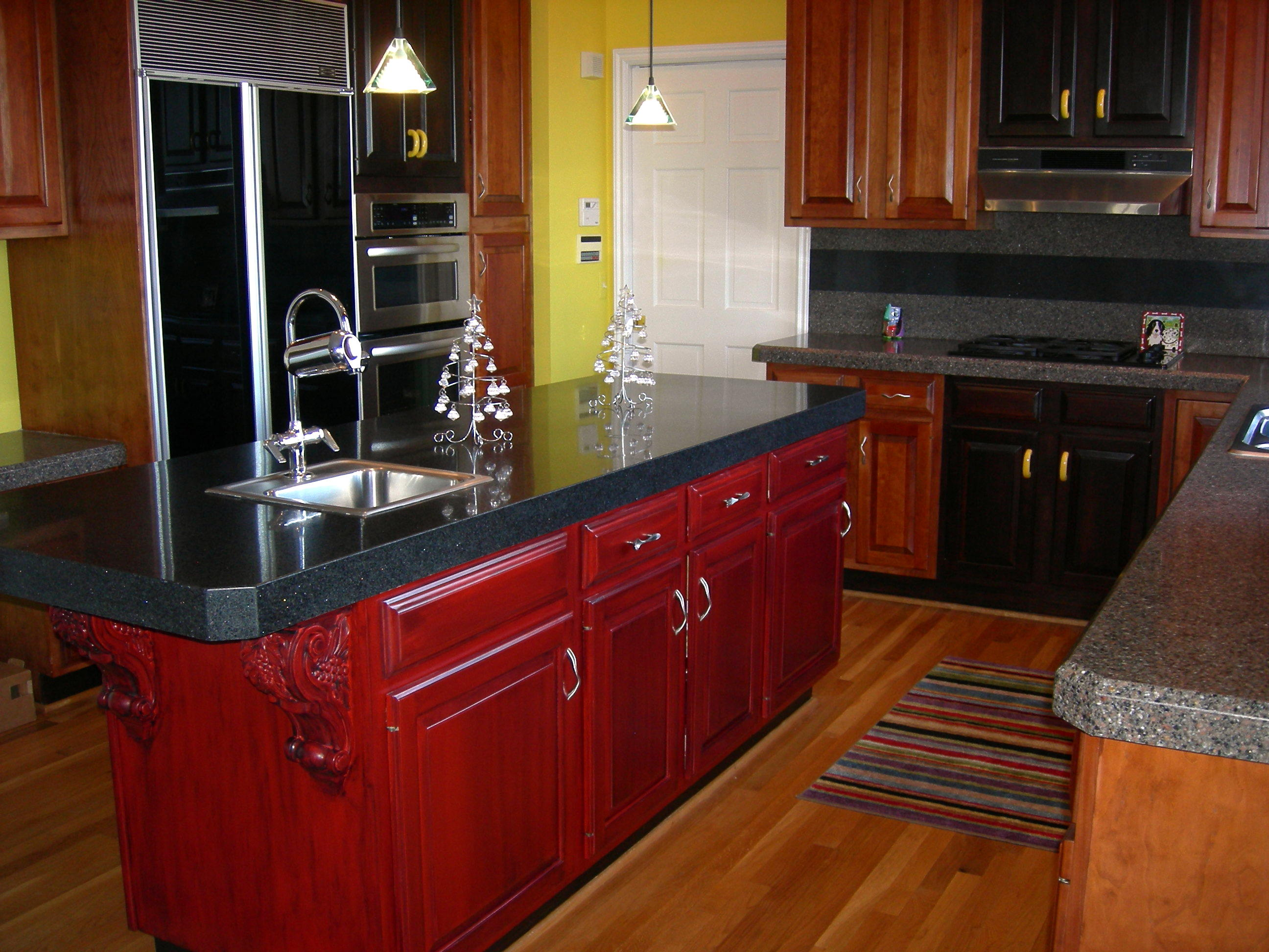 red kitchen Cabinet Refacing with black countertop plus sink with silver kitchen faucet plus chandelier
