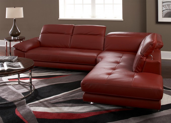 Red Sofa By Sprintz Furniture On Multicolor Carpet Plus Wooden Table Ideas