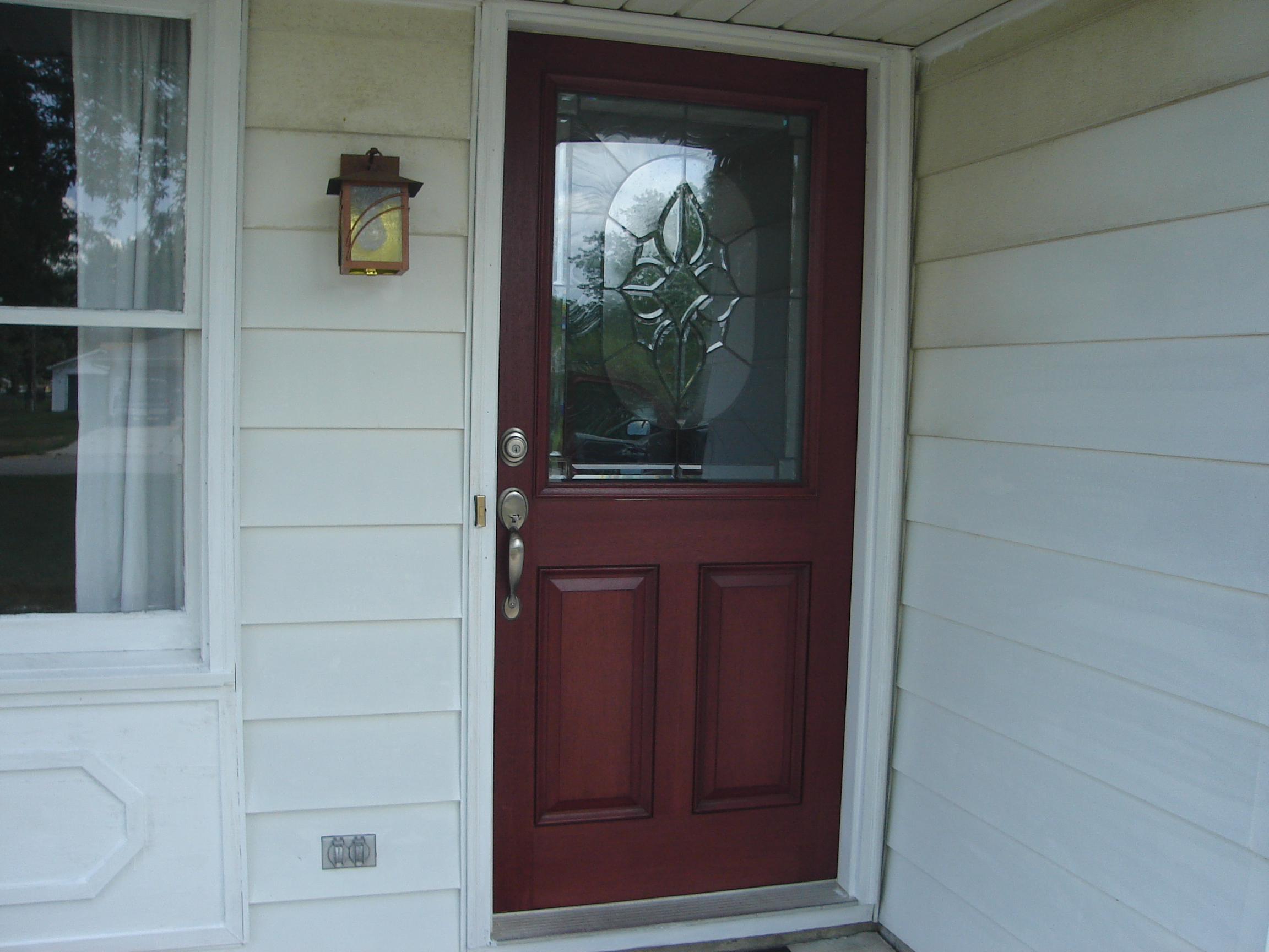 red therma tru entry doors with silver handle matched with white wall for exterior design ideas