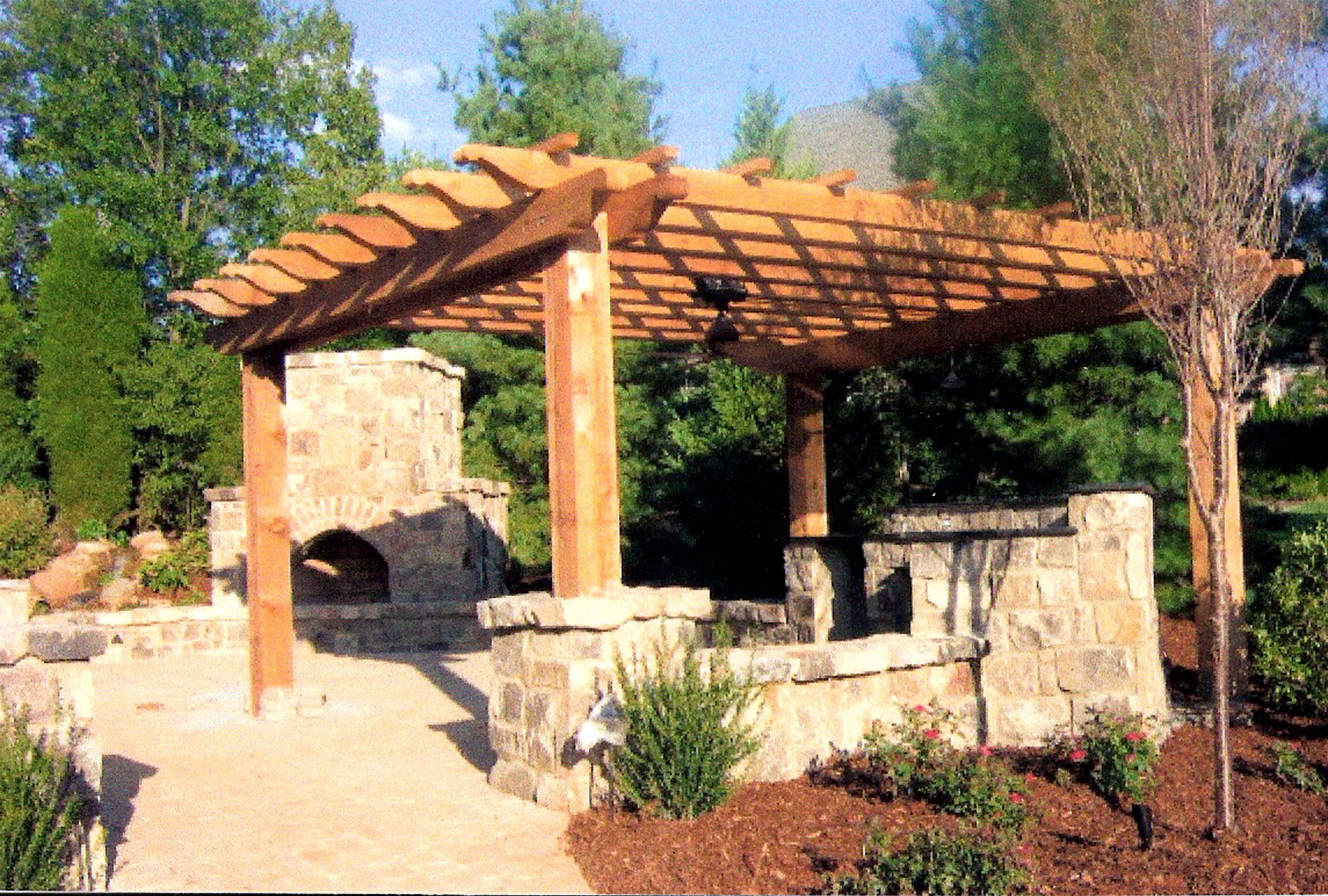 Regular Pergola plans ideas with stone veneer fireplace on the yard
