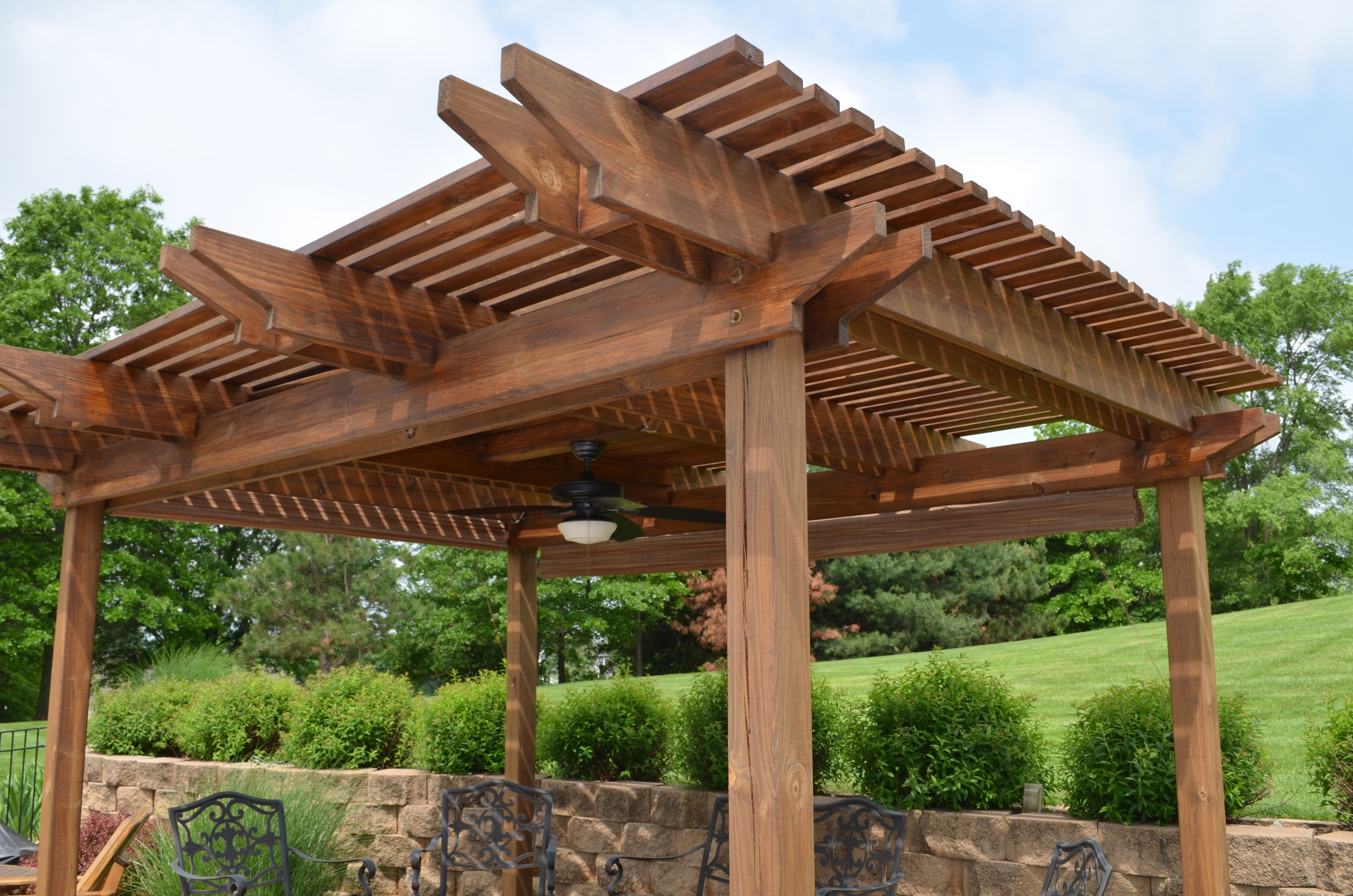 Regular wood Pergola plans ideas plus ceiling fan with light and chairs