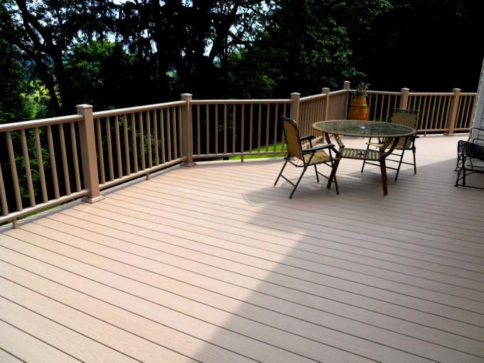 Rosybrown Azek Decking And Tan Railing Plus Chairs And Table For Deck Ideas