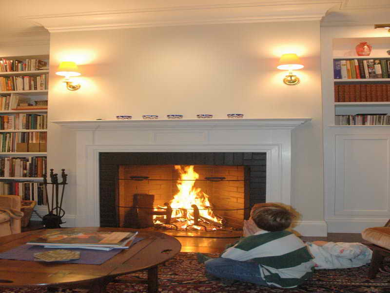 Rumford Fireplace matched with white wall and wooden floor plus double light and sofa set for family room ideas