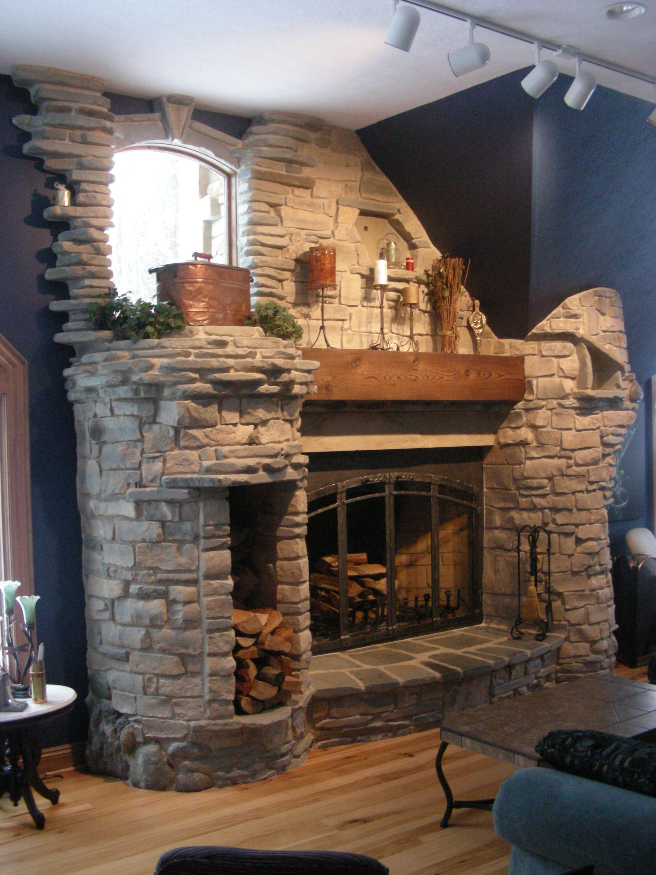 Rumford fireplace Natural stone matched with blue wall and wooden floor ideas