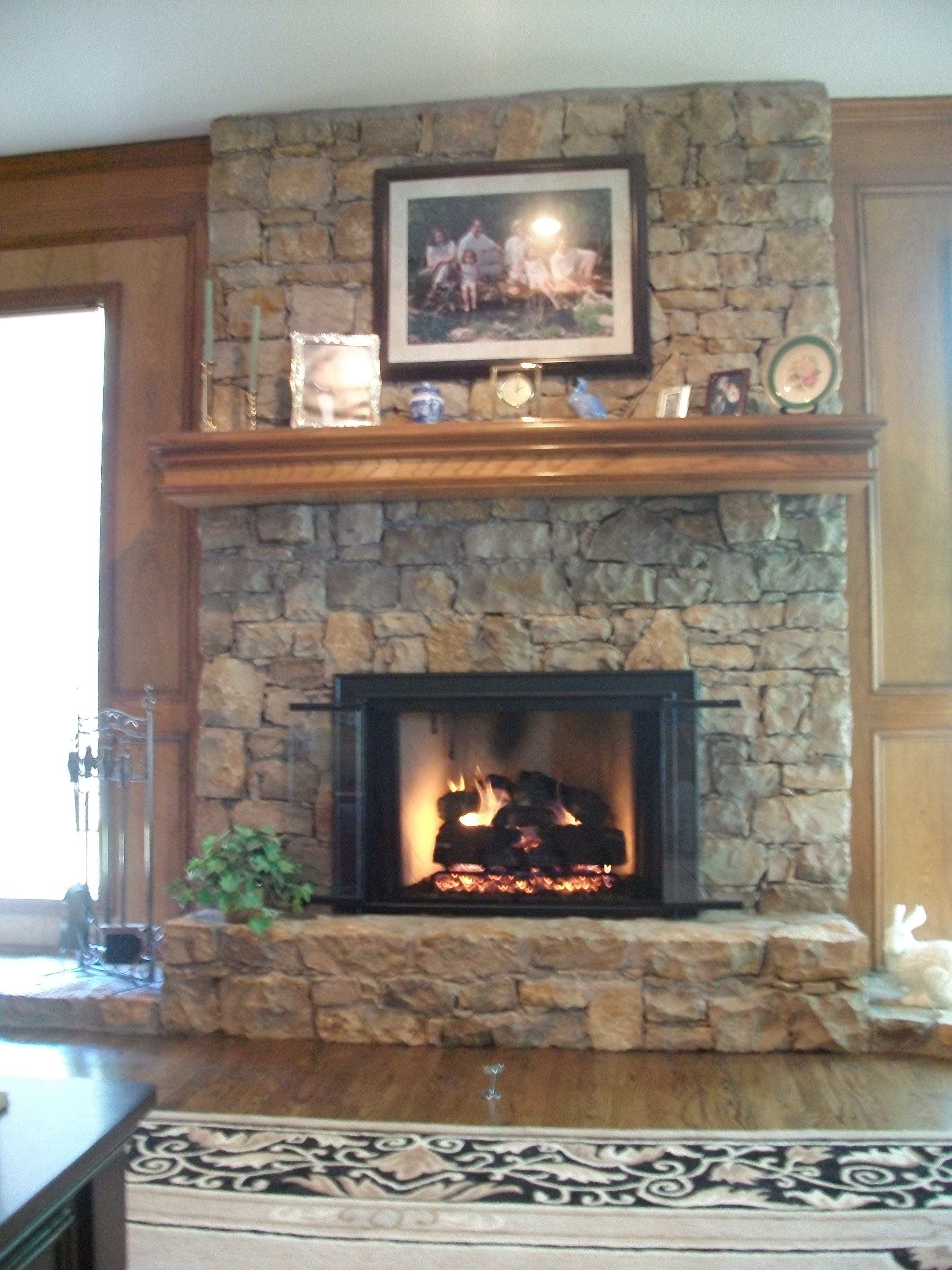 Rumford fireplace with black frame and natural stone mantel kit matched with wooden floor for heat warming decor ideas