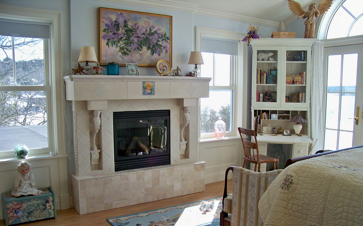 Rumford fireplace with black frame and white mantel kit matched with powder blue wall and cream floor plus blue carpet for family room ideas
