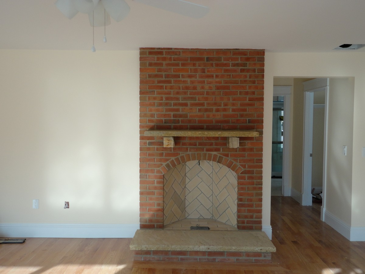 Rumford Fireplace with brick mantel kit matched with white wall and wooden floor for heat warming ideas