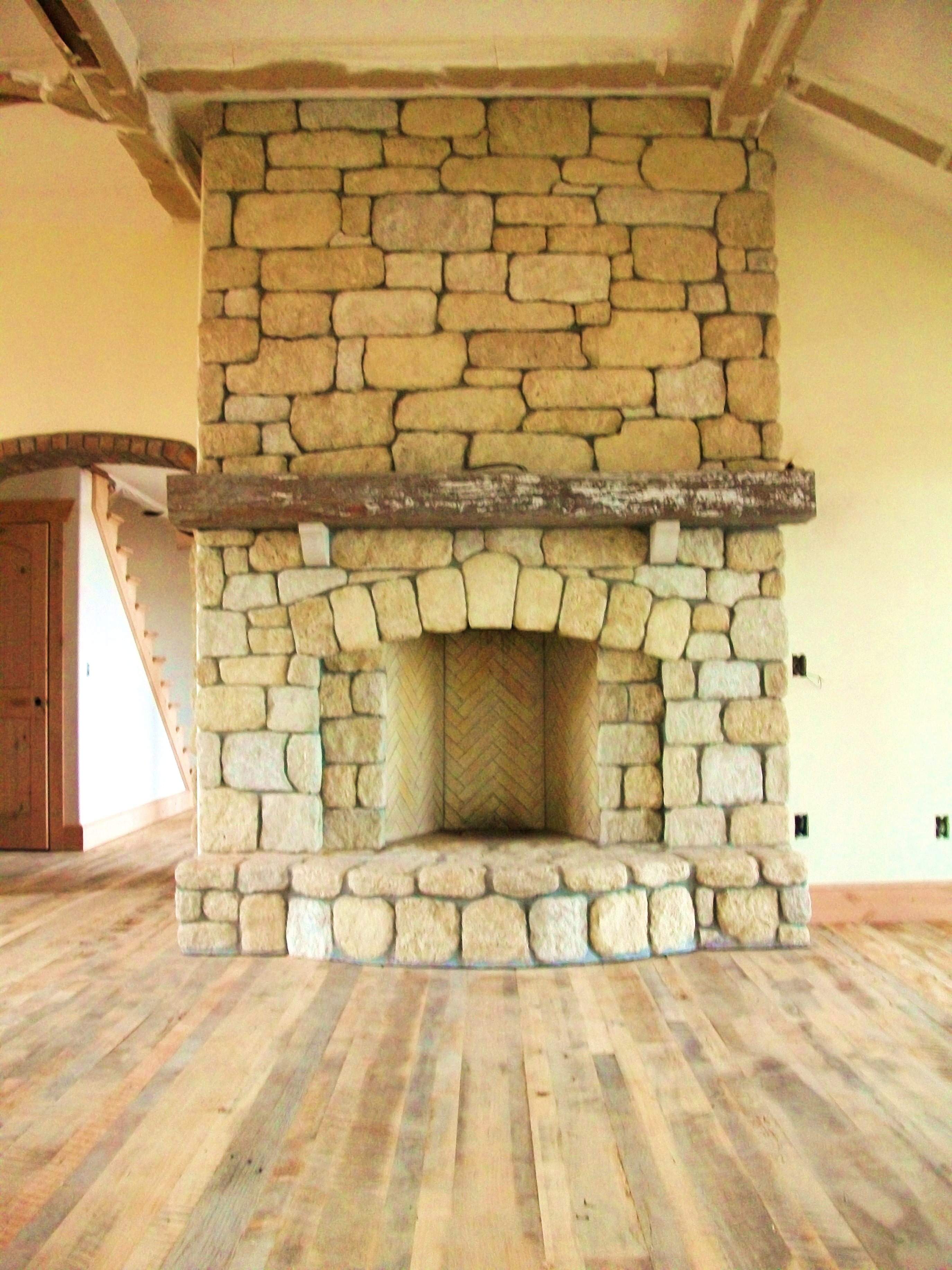 Rumford fireplace with natural stone mantel kit matched with wooden floor and white wall ideas