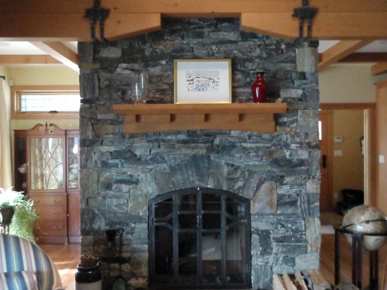 Rumford fireplace with natural stone mantel kit matched with wooden floor for heat warming room ideas