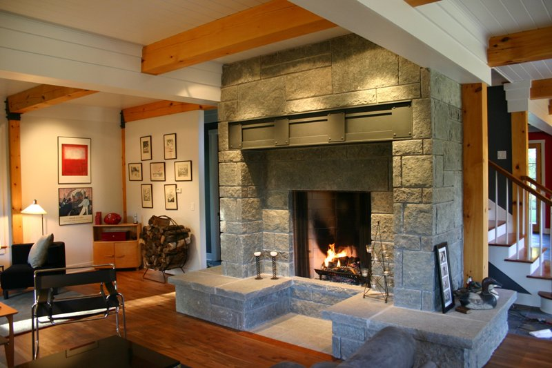 Rumford Fireplaces with stone mantel kit matched with wooden floor plus ofa and carpet for family room ideas