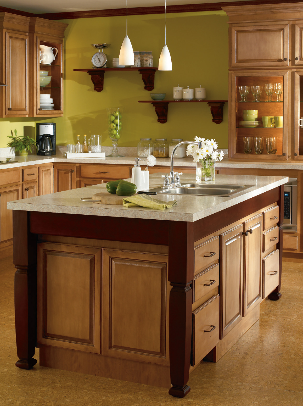 saddlebrwon aristokraft cabinets with white countertop matched with greenyellow wall for kitchen decor ideas