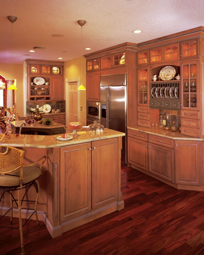 Sandy Brown Wooden Aristokraft Cabinets Matched With Marble Countertop And Wooden Floor For Kitchen Decor Ideas