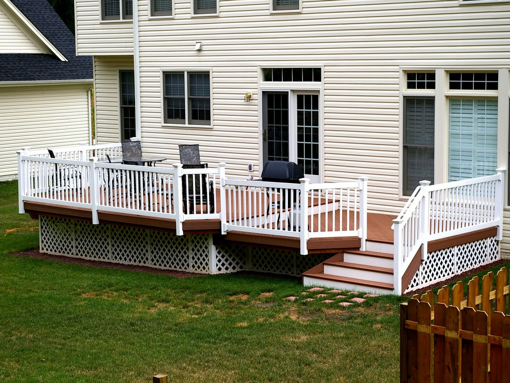 sienna evergrain decking matched with white railing plus chairs and stairs for deck ideas