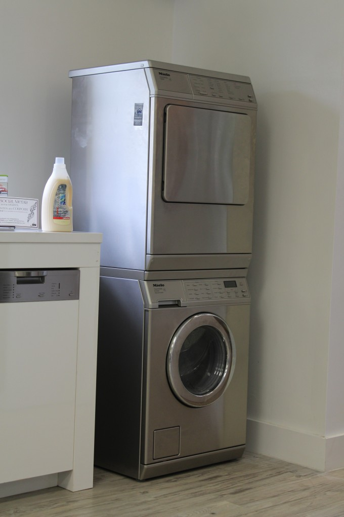 Silver Stackable Washer And Dryer With White Wall For Laundy Room Ideas
