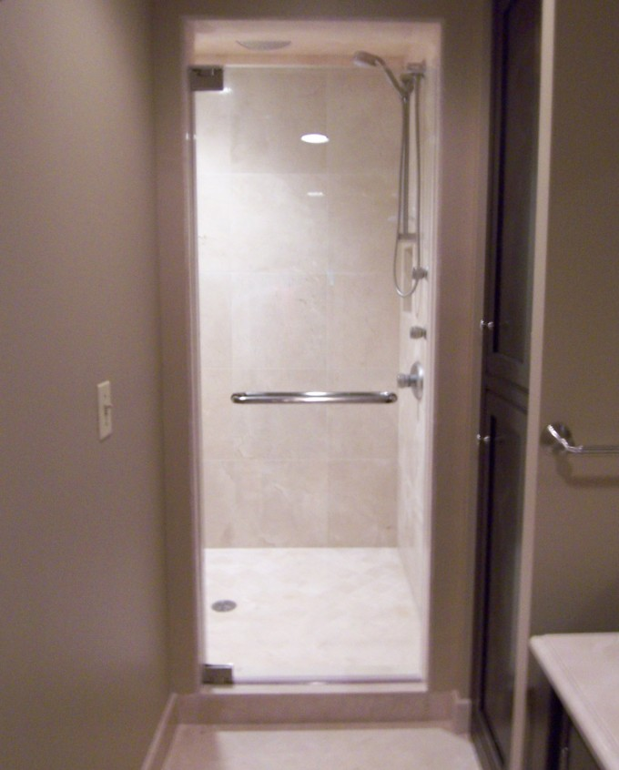 Single Frameless Shower Doors With Silver Towel Hanger With Wheat Wall And Floor