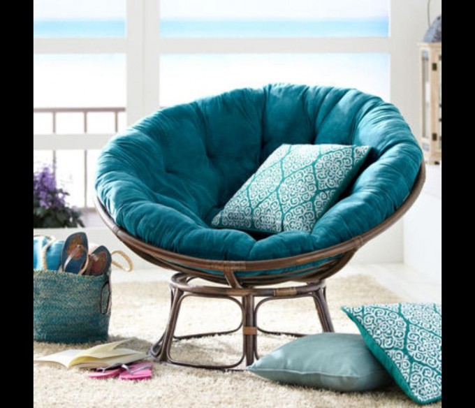 Single Papasan Chair With Blue Solid Fabric Cushion On White Carpet