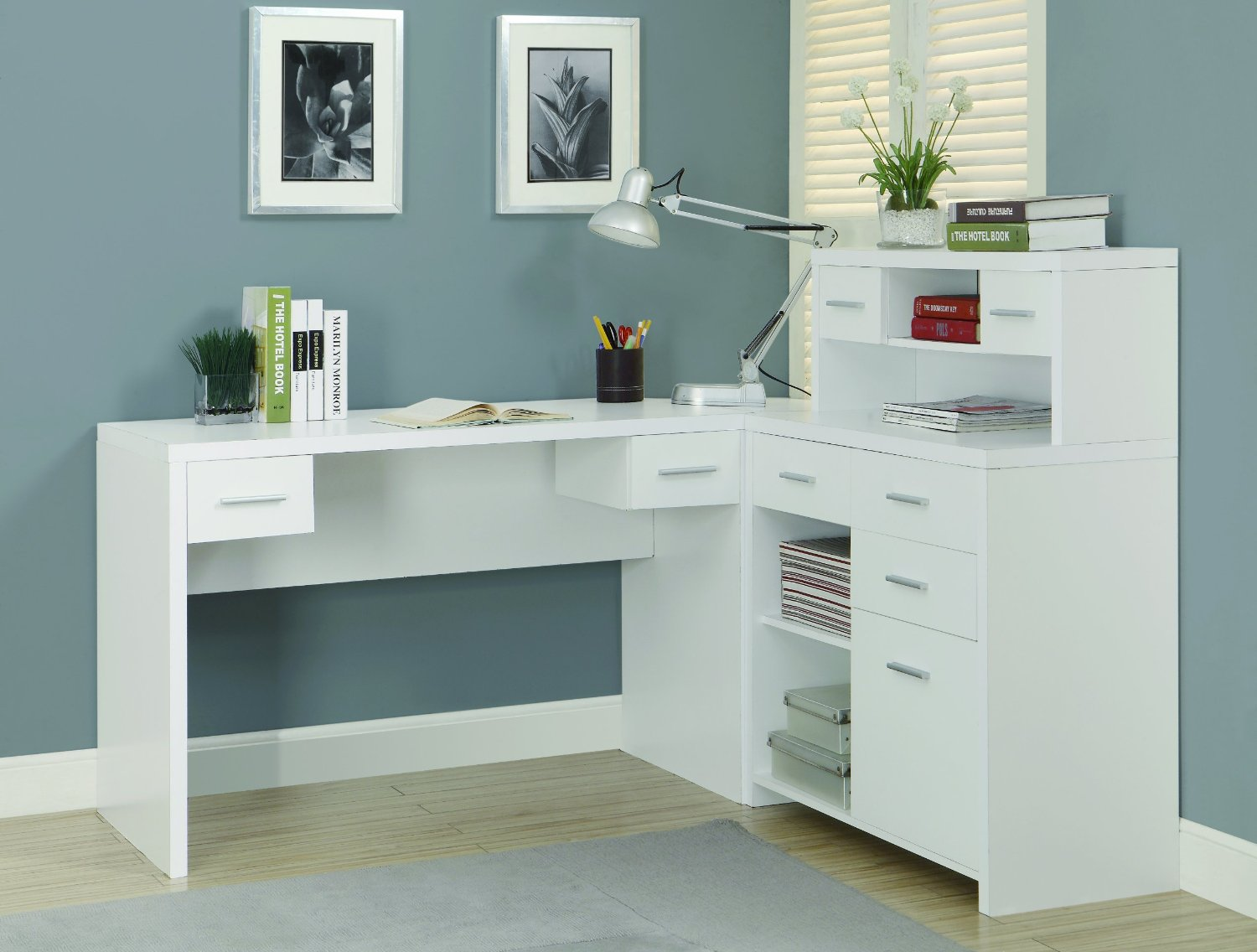 snow white L shaped Desk with Hutch plus drawer with silver handle on a workspace with blue wall and wooden floor