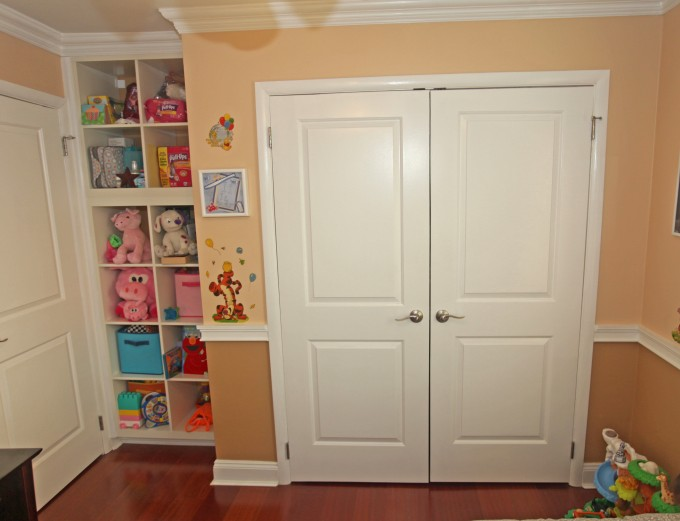 Stunning Folding Closet Doors Ideas With Tan Wall Plus Picture Plus Toy Storage And Wooden Floor For Kids Room Ideas