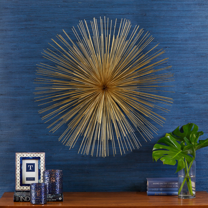 stunning golden Starburst Wall Decor on blue wall ideas