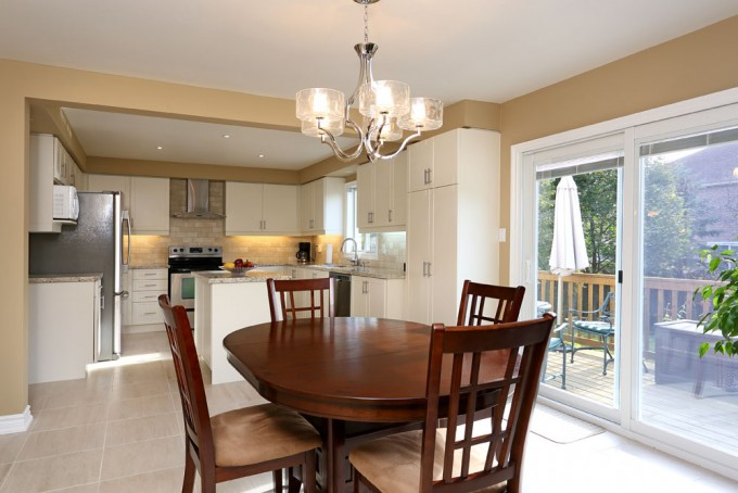 Stunning Kitchen Cabinet Refacing In White Plus Oven And Frige Plus Wooden Brown Dining Table Plus Chandelier