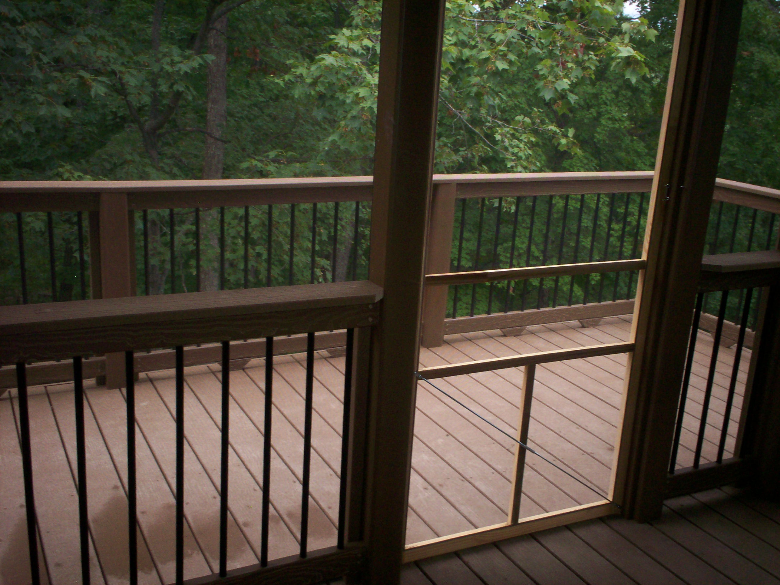 tan evergrain decking matched with black and tan railing for patio decor ideas