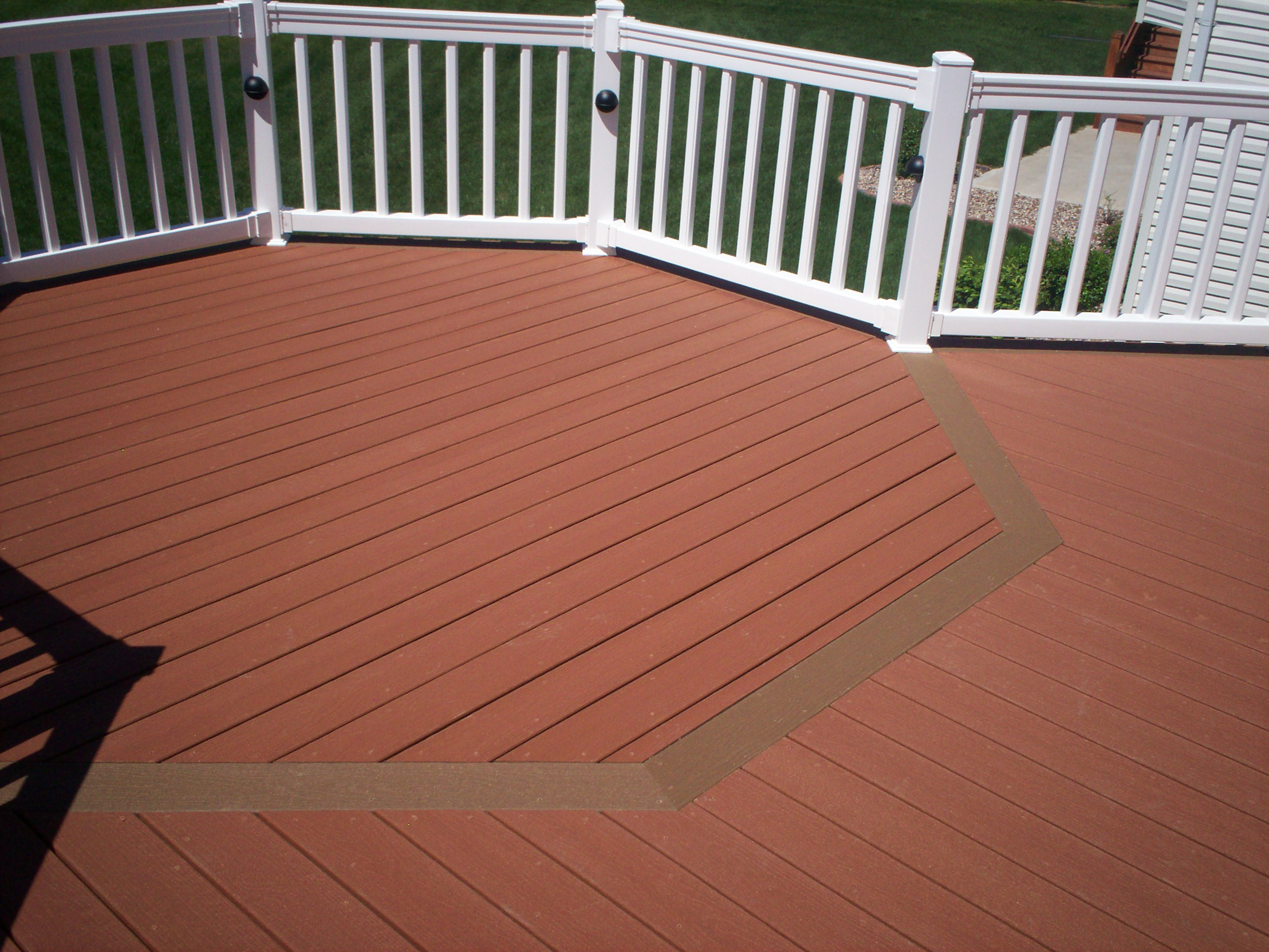 terra cotta evergrain decking matched with white railing for charming patio ideas