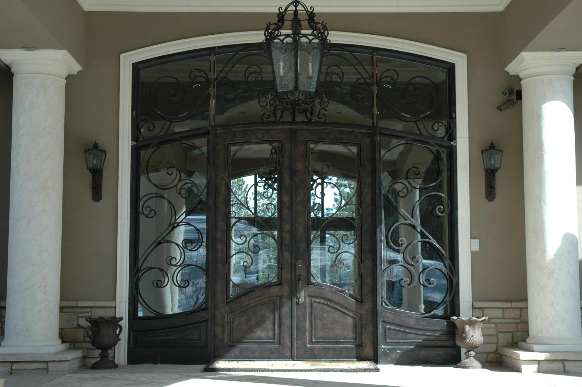 unique black therma tru entry doors matched with tan wall plus chandelier ideas