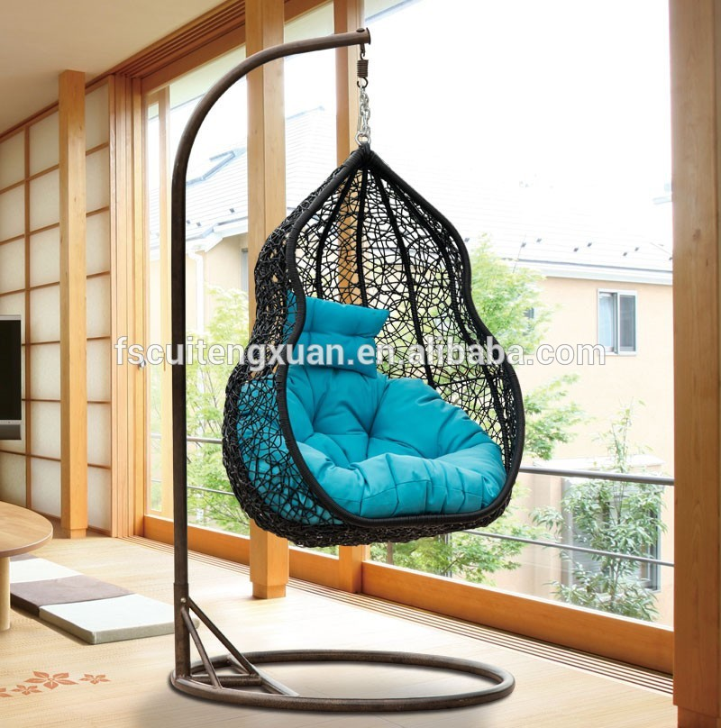 unique black wicker rattan swingasan chair with blue cushion and iron stand ideas