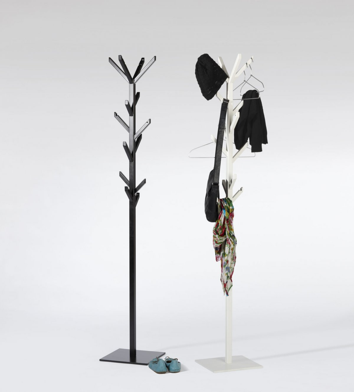 unique standing coat rack in two option colors which are black and white