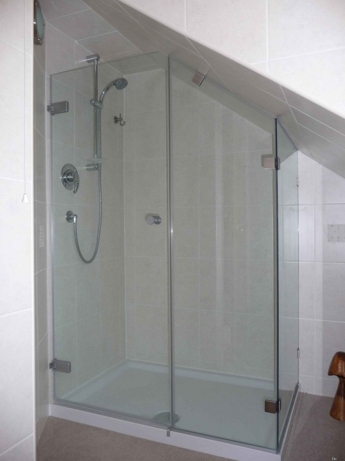 Upscale Frameless Shower Doors Matched With White Wall Plus Silver Shower Faucet For Bathroom Ideas