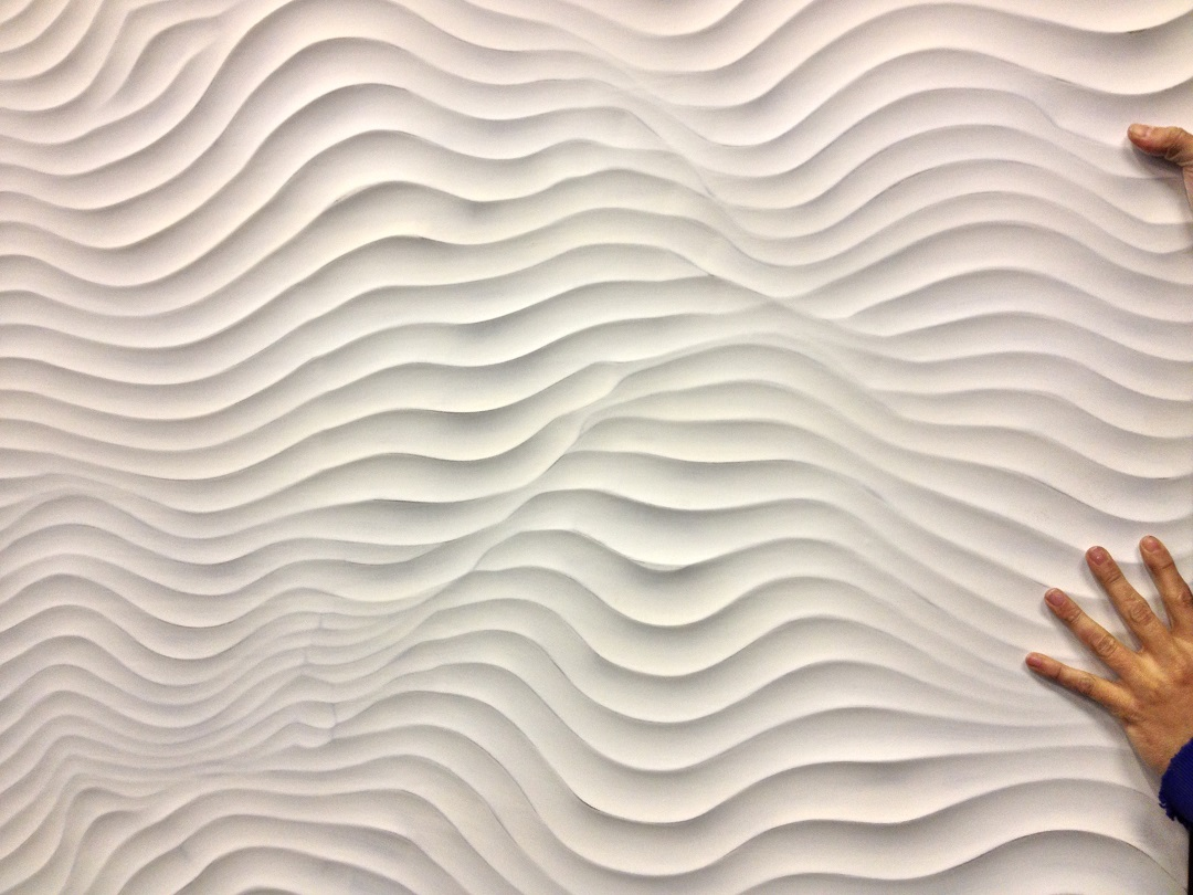 wavy pattern of textured wall panels in white for wall decor ideas