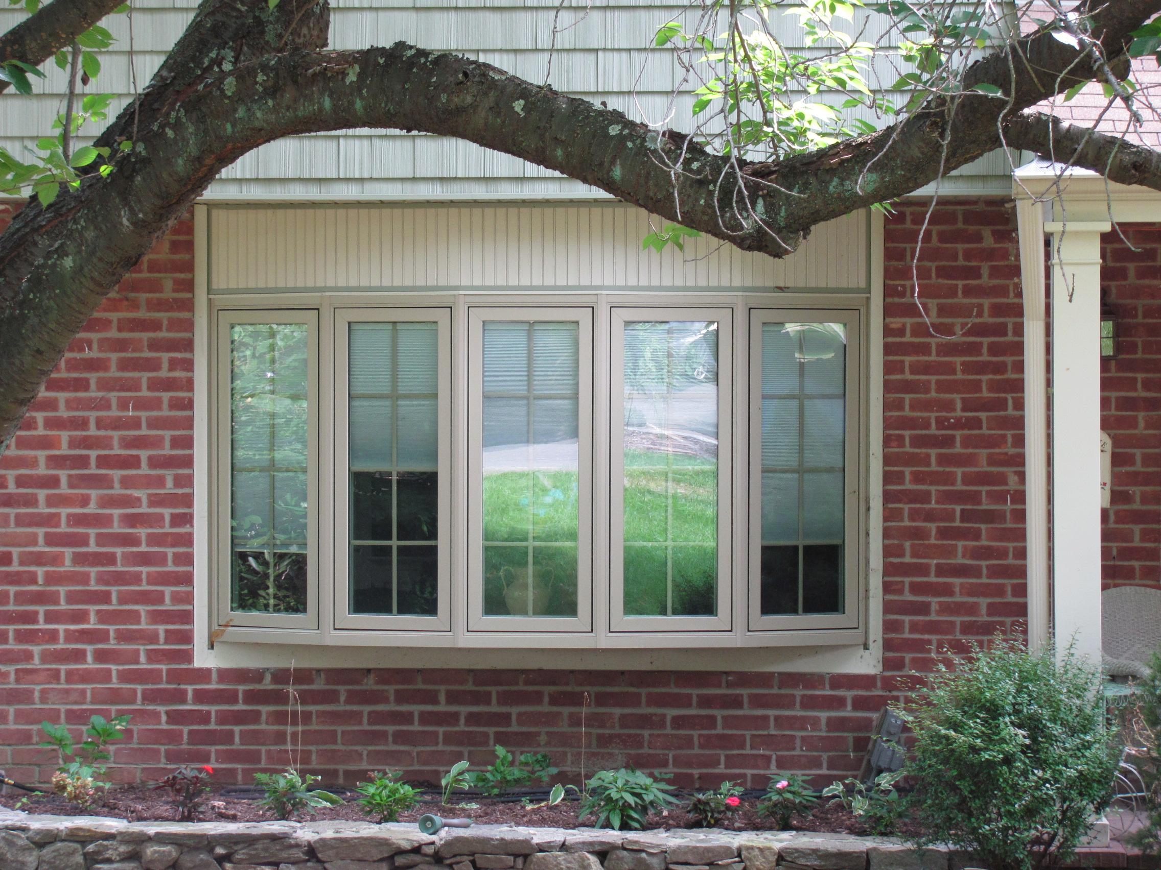 wheat pella windows matched with terra cotta brick wall ideas