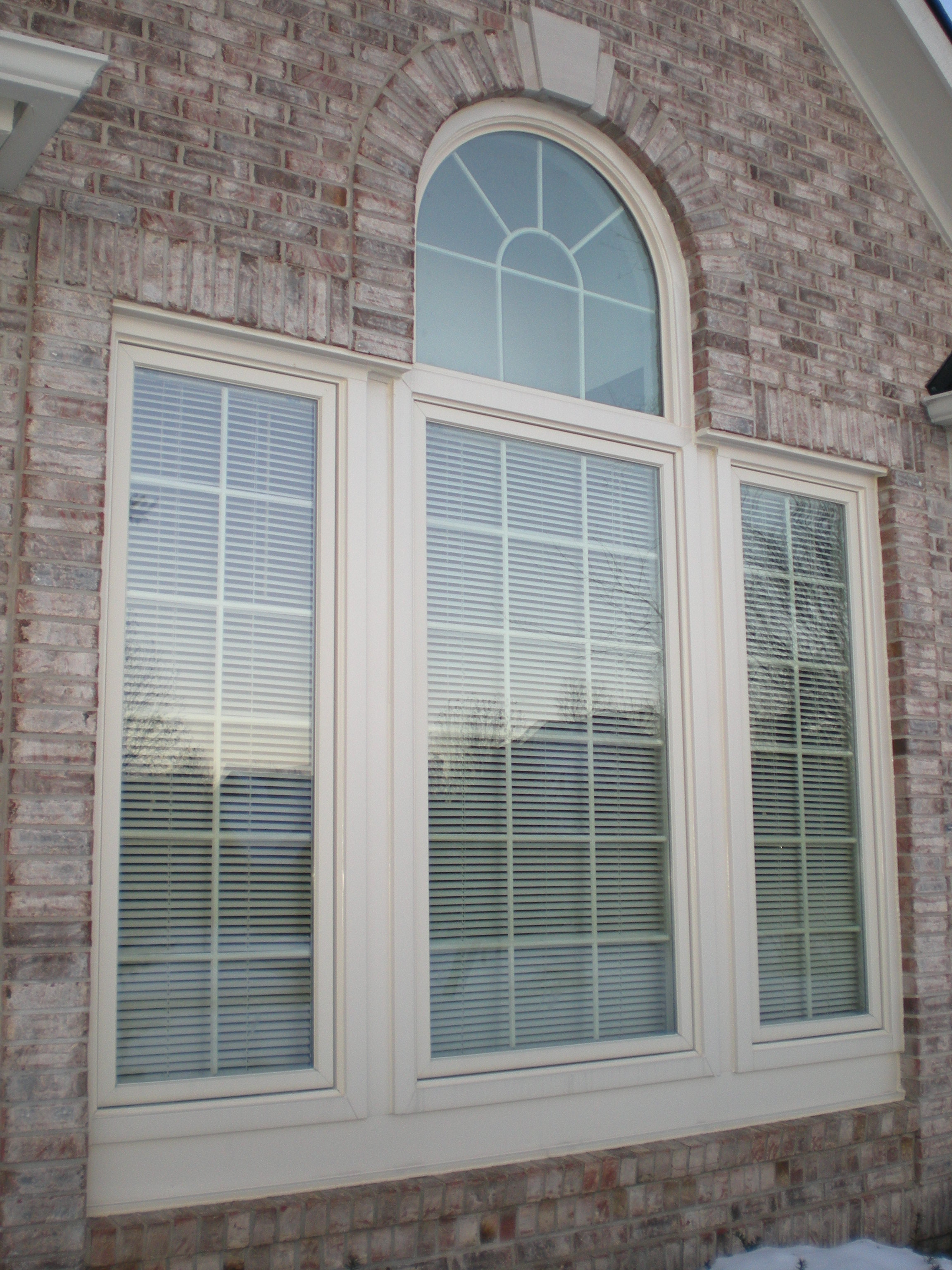 white arch bay pella windows matched with brick wall ideas
