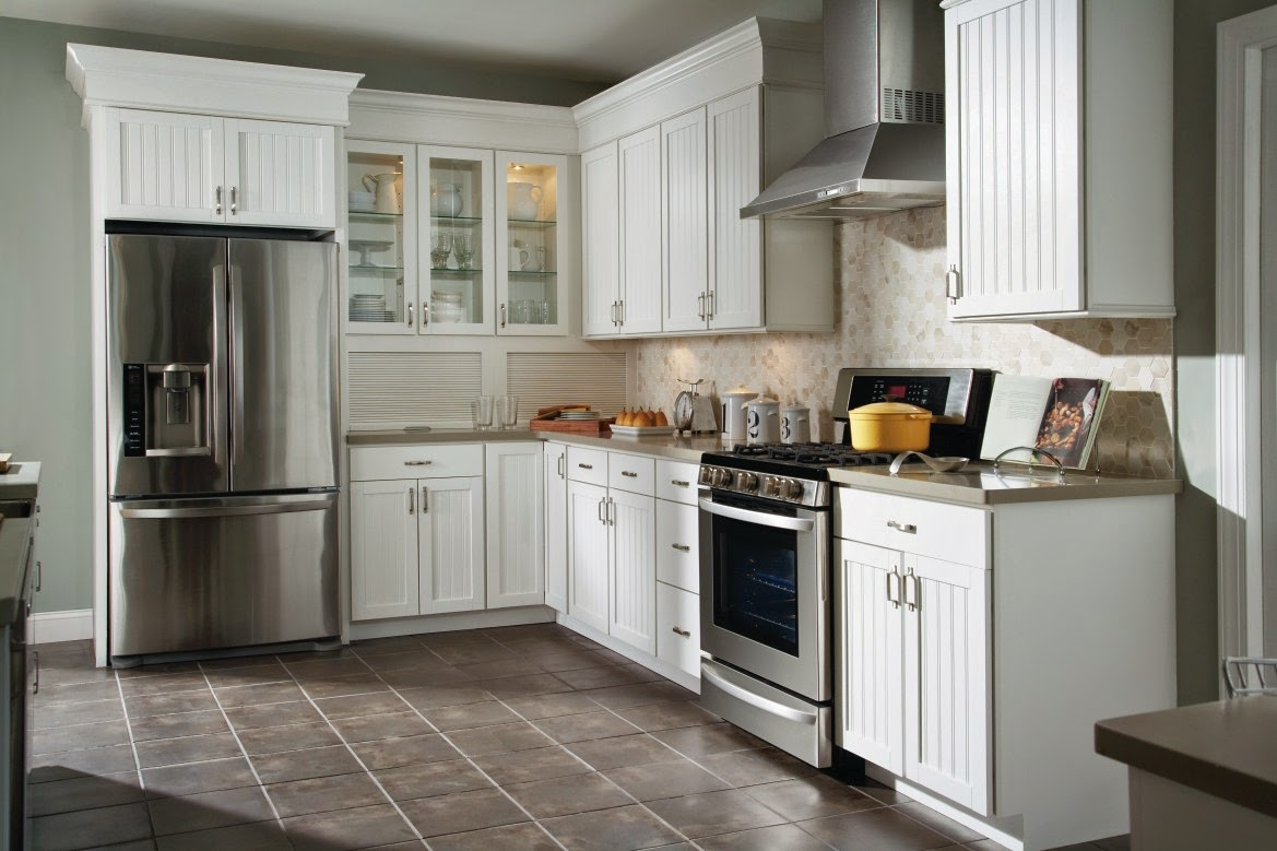 white aristokraft cabinets with white back splash plus oven and frige plus grey floor for kitchen decor ideas