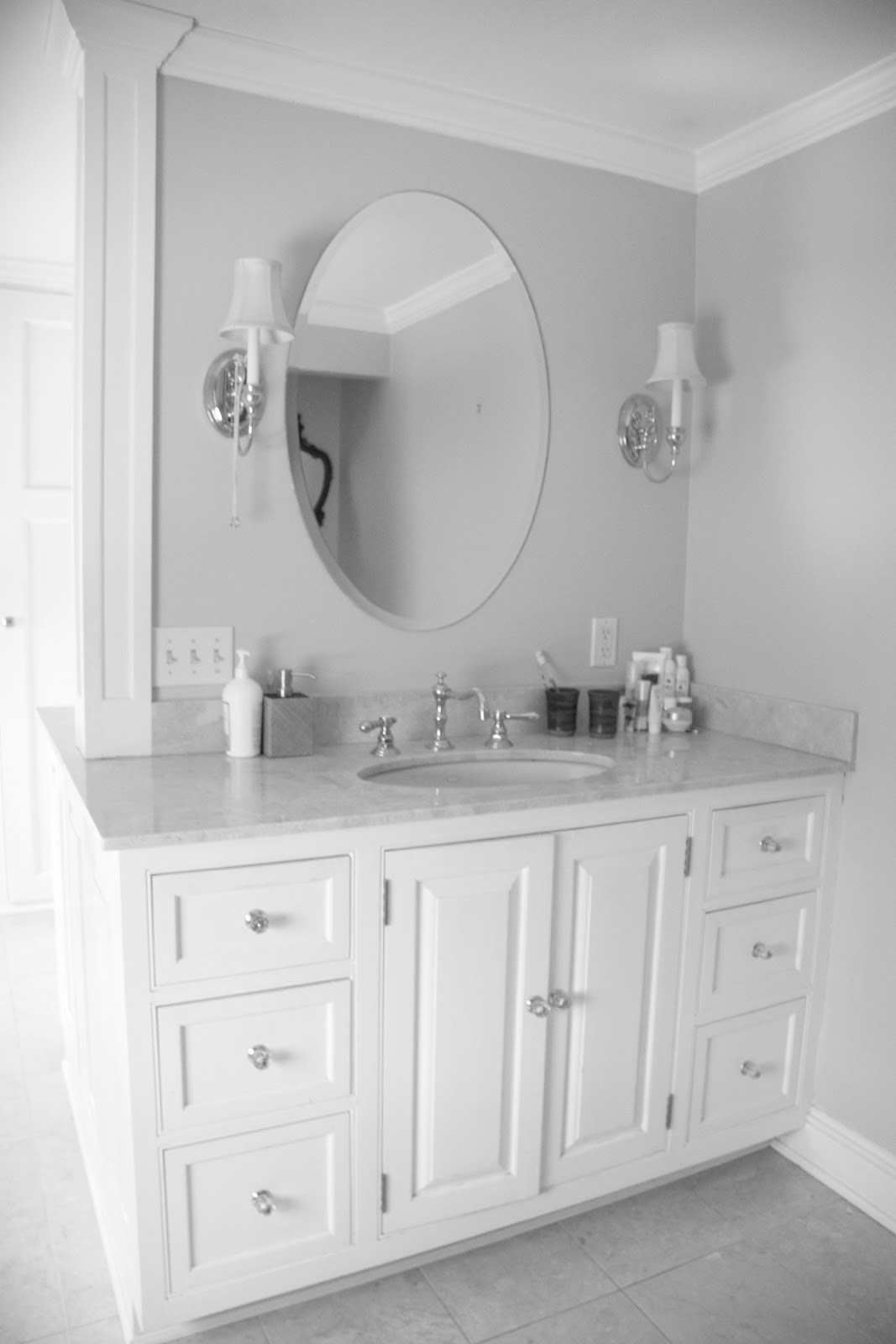 white bathroom with lowes bathroom lighting plus round mirror plus sink with cabinet ideas