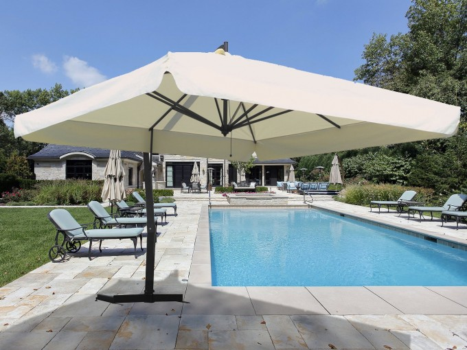 White Cantilever Umbrella With Black Stand Near The Swimming Pool For Patio Ideas