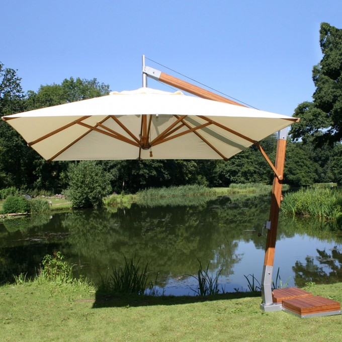 White Cantilever Umbrella With Metal Stand Near The Lake For Back Yard Ideas