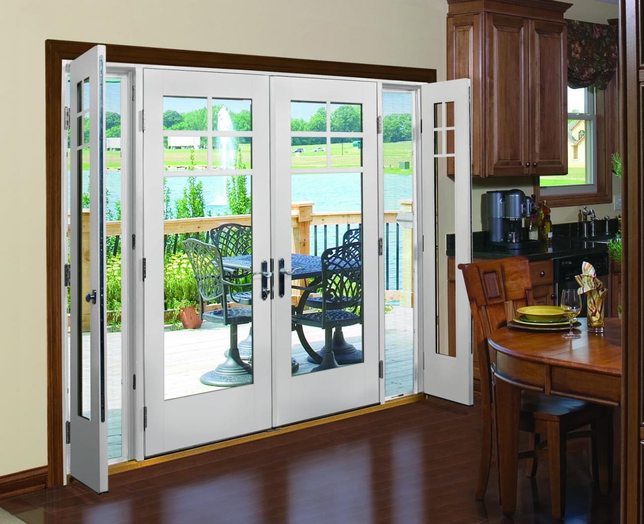 white double therma tru entry doors with silver handle matched with white wall and wooden floor ideas