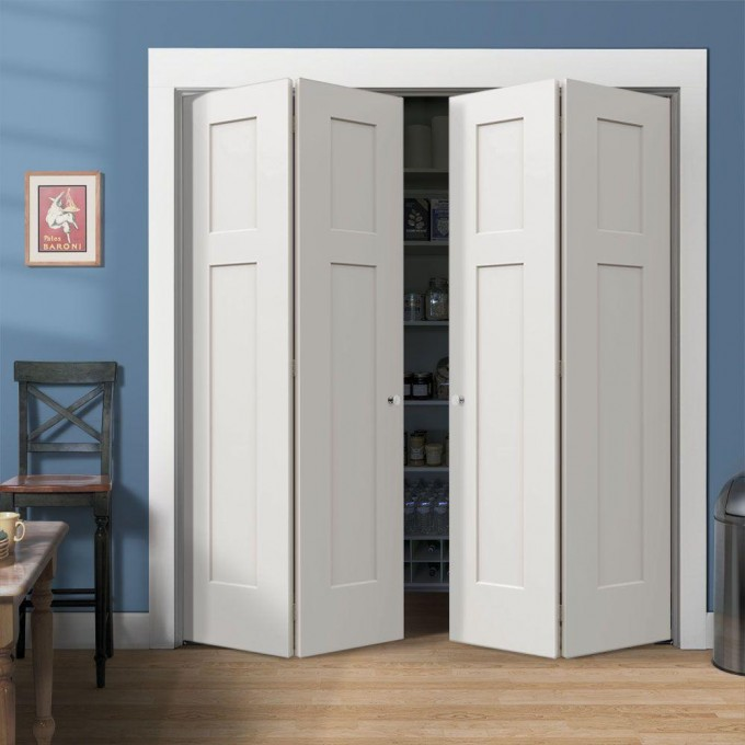 White Folding Closet Doors On Blue Wall With Baseboard Molding Plus Wooden Floor Plus Chair