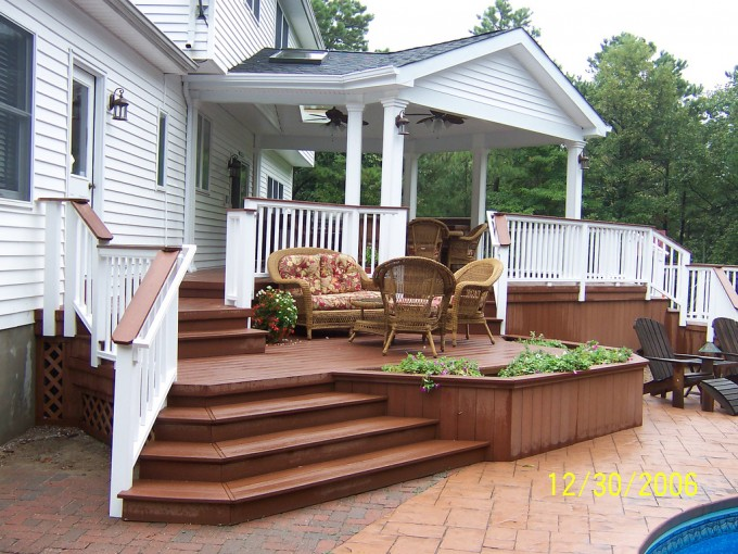 White House With Brown Evergrain Decking Matched With White Railing Plus Rattan Sofa Set Ideas