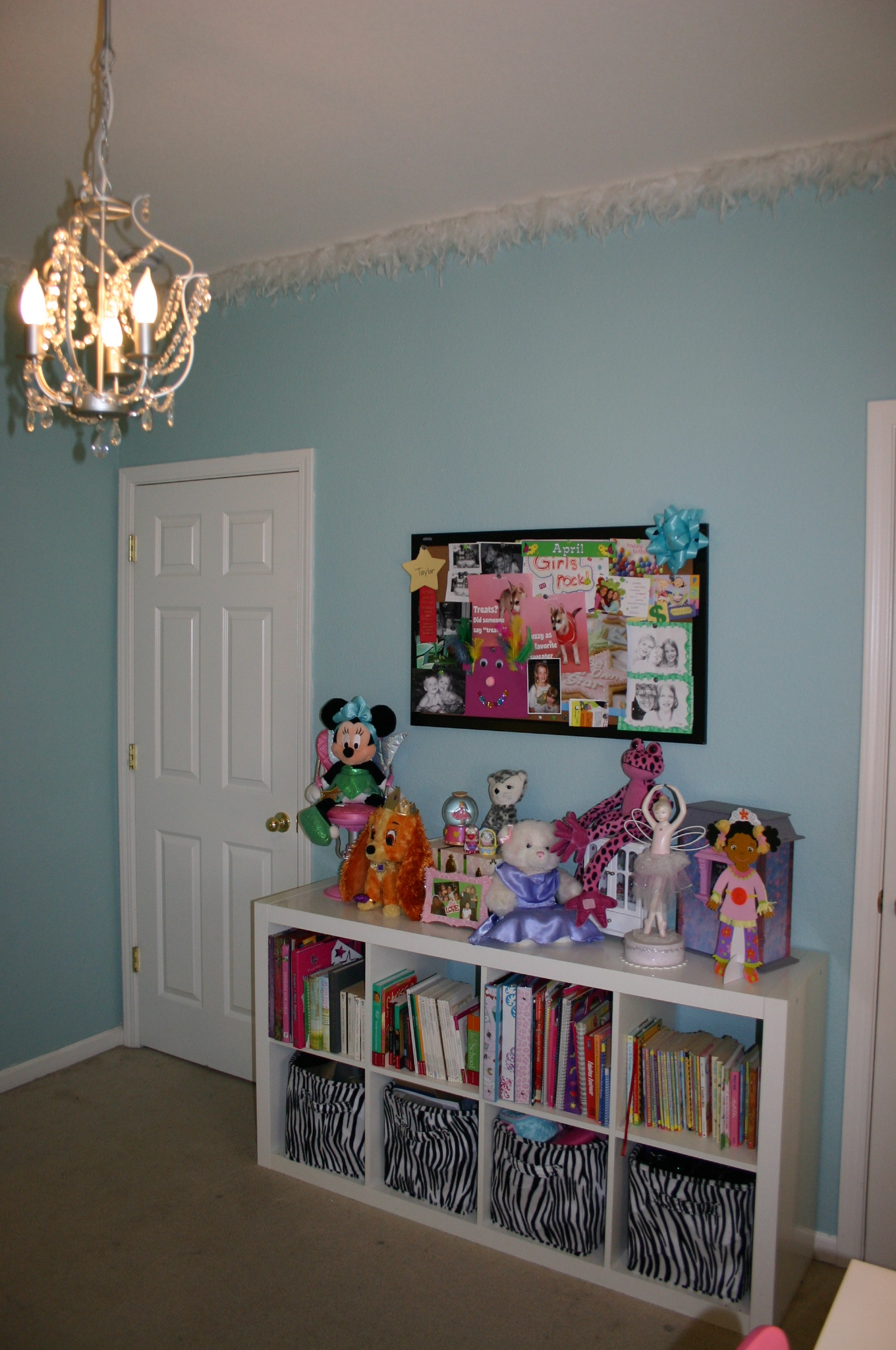 white ikea expedit bookcase filled with books on kids room with blue wall and white door