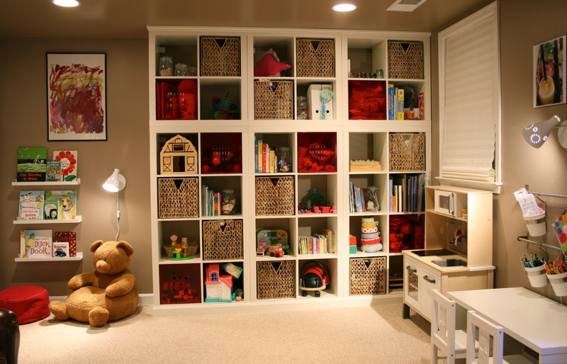 white ikea expedit bookcase on kids room with teddybear doll and desk plus some books