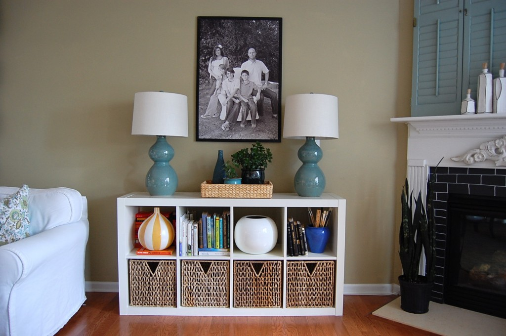 white Ikea Expedit Bookcase with rattan storage with double table standing lamp above ideas with picture on cream wall and wooden floor