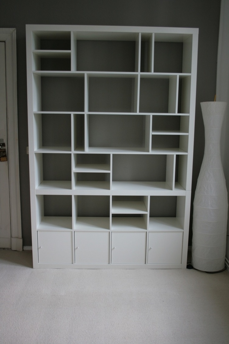 white Ikea Expedit bookcase with storage at bottom ideas with grey wall plus white jar and white wall