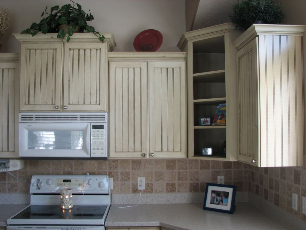 white Kitchen Cabinet refacing with white countertop plus white oven for kitchen decor ideas