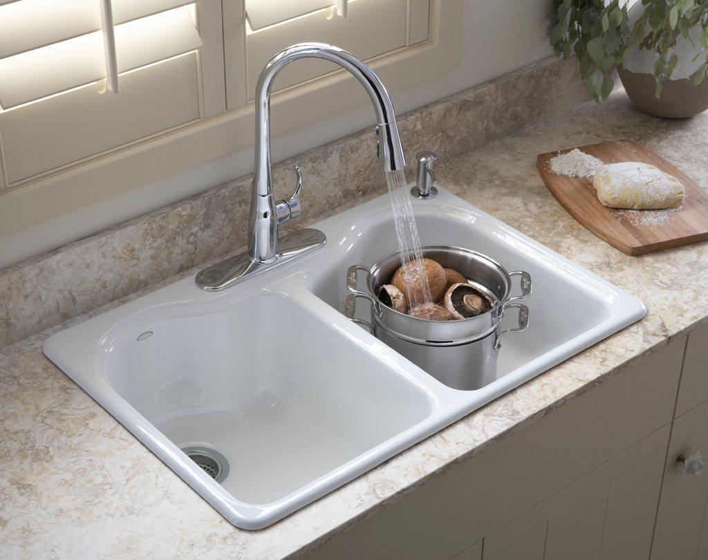 white kitchen kohler sinks and stainless steel faucet on cream countertop ideas