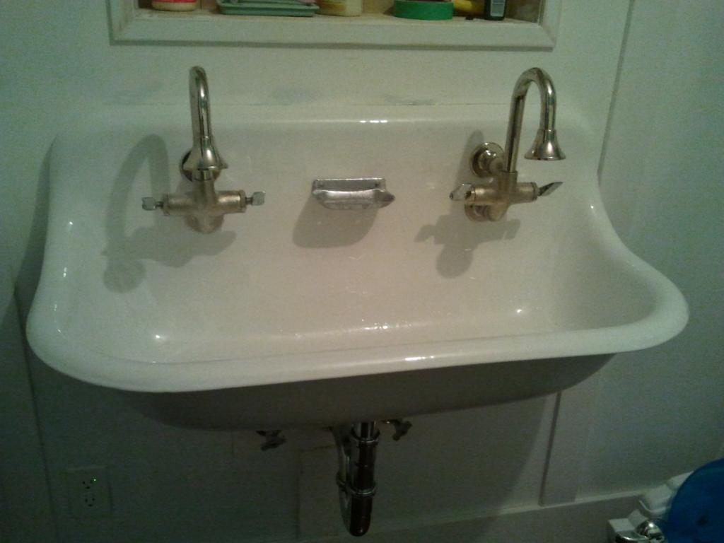 white kohler sinks plus double faucet and a mirror for bathroom ideas
